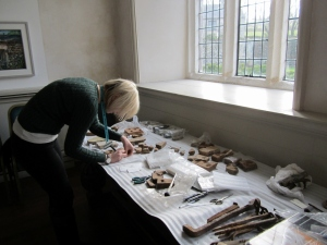 visitor services manager working on re packing late medieval floor tiles