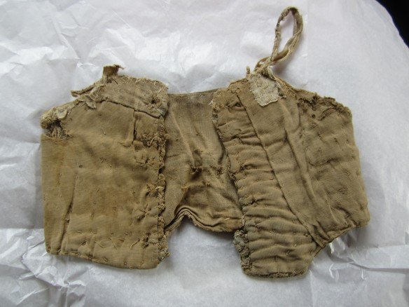 Childs 'corrset' stiffened with thick string and there are remains of bone stays