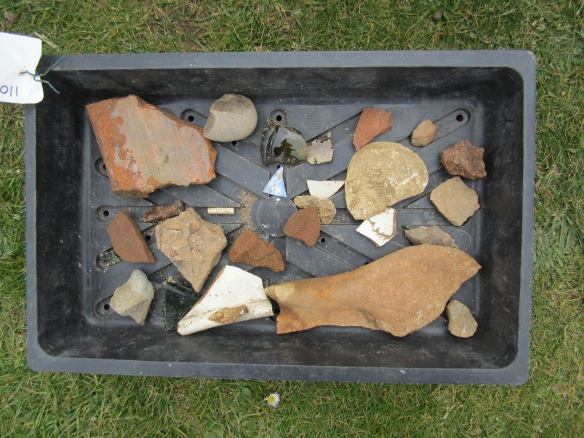 Finds from the topsoil, including local 18th century earthern ware, flint and galss
