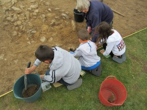 Three young archaeologist, being 'trained' by Millie