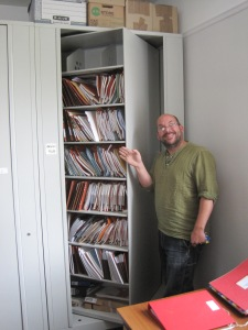 Jim the National Trust Archaeologist based in Cornwall with his organized paper archive.