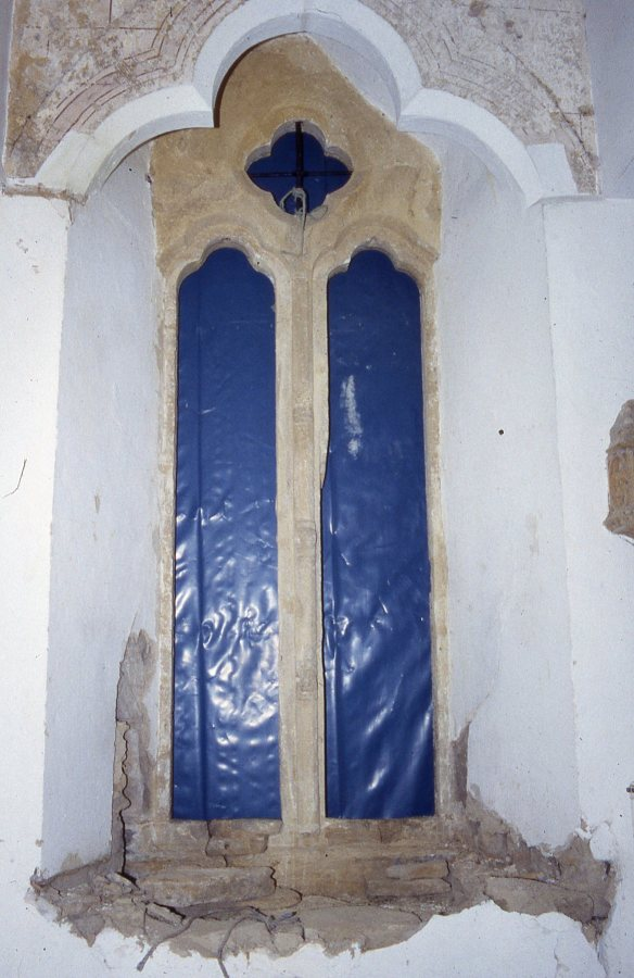 The 13th- century solar window as we first saw it with a few red lines exposed.