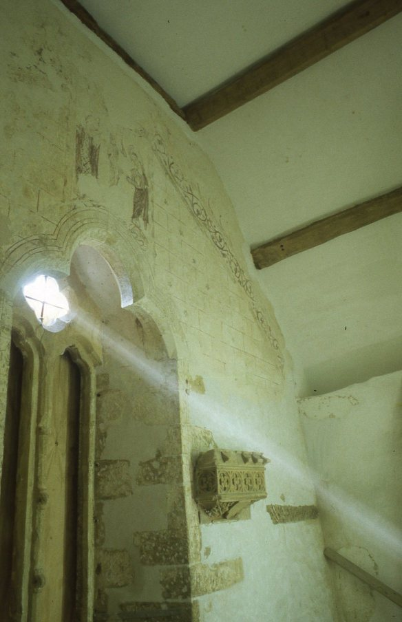 The wall painting after conservation. Notice that very little survives below where the ceiling was because the room was replastered and decorated on many occasions but in the attic it remained unchanged. A 15th century light bracket to the right of the window.