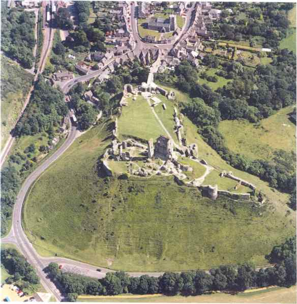 The Inner Ward Gate is below and slightly to the right of the tall Keep tower at the centre of the picture. Corfe looking south towards the village. The castle https://archaeologynationaltrustsw.wordpress.com/wp-admin/post-new.php?post_type=post#is divided into three main areas, the Outer Bailey is entered first across the bridge from the church and through the Outer Gatehouse, then up the hill to the South West Gatehouse which gives access to the West Bailey. Up the hill again to the highest stronghold of the Inner Ward where remains of Henry I's  great tower Keep and King John's manor house still stand.