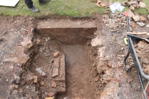 The basement floor of the conservatory with brick support wall for the now destroyed conservatory tiled floor.