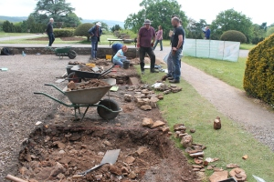 Today's trenches showing the heap of rubble we needed to dig through with selected architectural bits we set aside.