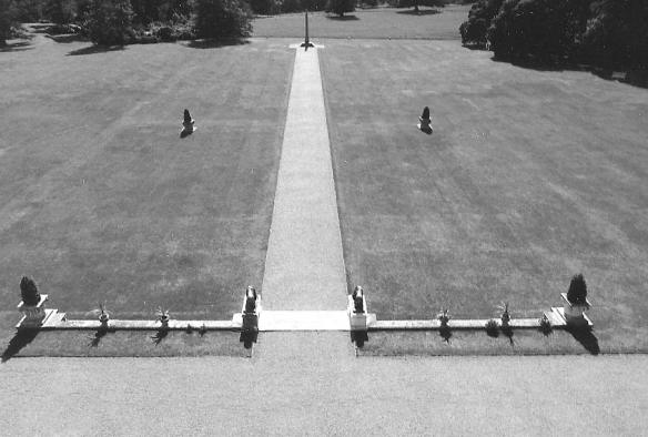 Kingston Lacy south lawn from the terrace showing the path to the centrally placed Egyptian obelisk from the Isle of Philae. James the curator has found letters from William John that indicate that he helped Champolion decipher the hyroglyphic writing that enabled the understanding of Ancient Egyptian history. The obelisk like the Rosetta   Stone has an inscription in more than one language.
