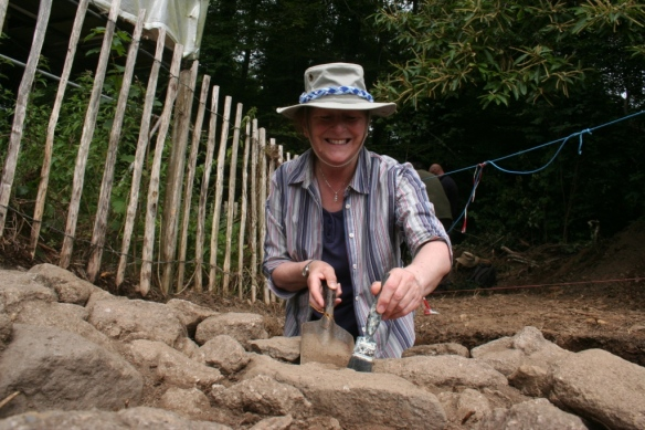 Volunteer Barbara does a final clean of the ramp in trench F.