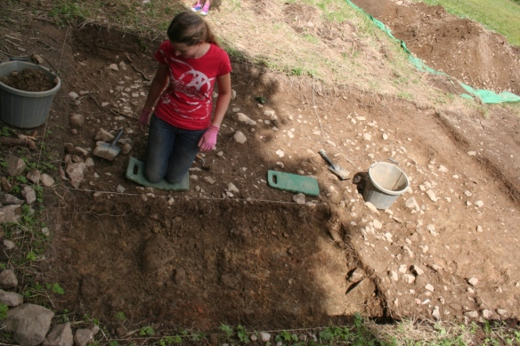 Louisa does a final clean of the medieval trackway.