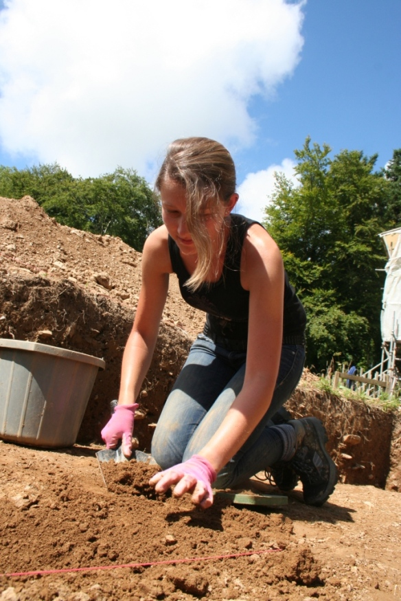 Louisa excavates a ditch below the late medieval topsoil.