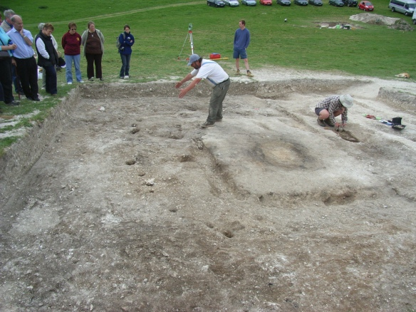 One of the Late Neolithic houses at Durrington Walls (c.2500BC) contemporary with the trilithon building phase of Stonehenge. The central hearth had two indentations beside it, worn by the knees of people tending the fire.