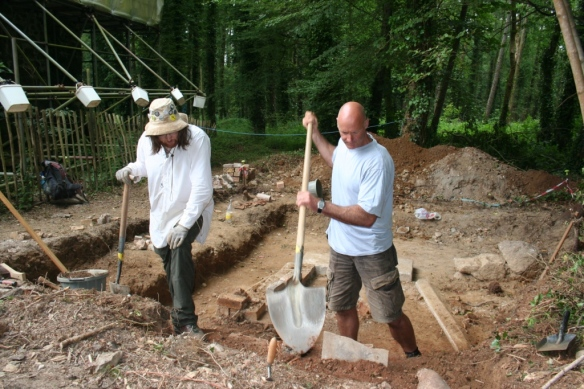 Volunteers uncover more of the kiln in trench D.