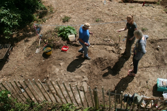 Beginning to reveal the Cider House ramp in trench F