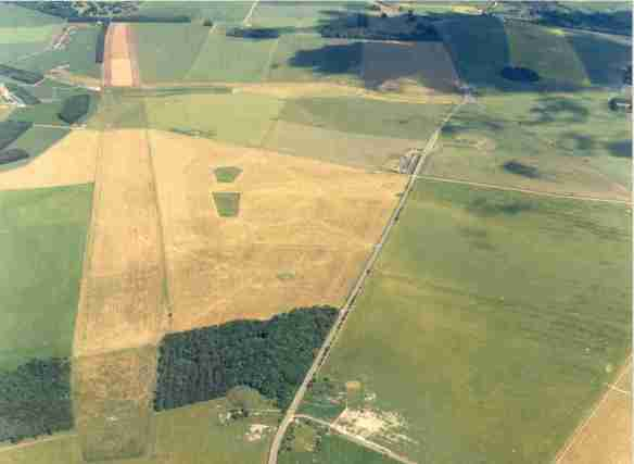 The 2.8km long feature following the left side of picture is the Greater Cursus an Early Neolithic 'processional way' (no one really knows what this long thin, banked enclosure was for. The blobs to the right of the Cursus, left of centre in the picture are part of the Early Bronze Age Cursus Barrow Group.  Centre bottom to top right runs the A344 which has recently been closed. Stonehenge lies to the right of this road above the car park and the Avenue lies opposite on the left side of the road turning almost through 90 degrees after a few hundred metres to run up the hill to the King Barrow Ridge at the top of the picture.