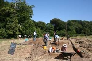 Volunteers made lots of progress today on trench A.