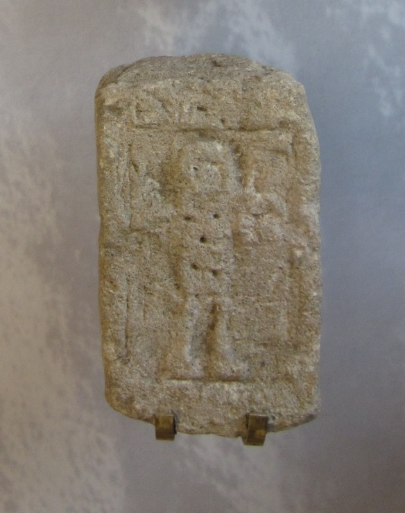 The figure on the alter holding a spear and sheild.