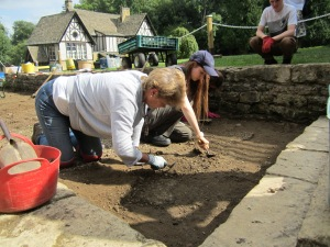 Jackie (who's birthday was today) Harriet and Hannah digging up the gravel and tarmac