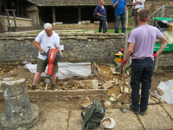Mark on the jack hammer and George talking with visitors while waiting to use the sledgehammer