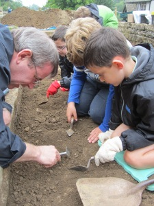 Allan helping Thomas and Tom to excavate a large fragmant of tile