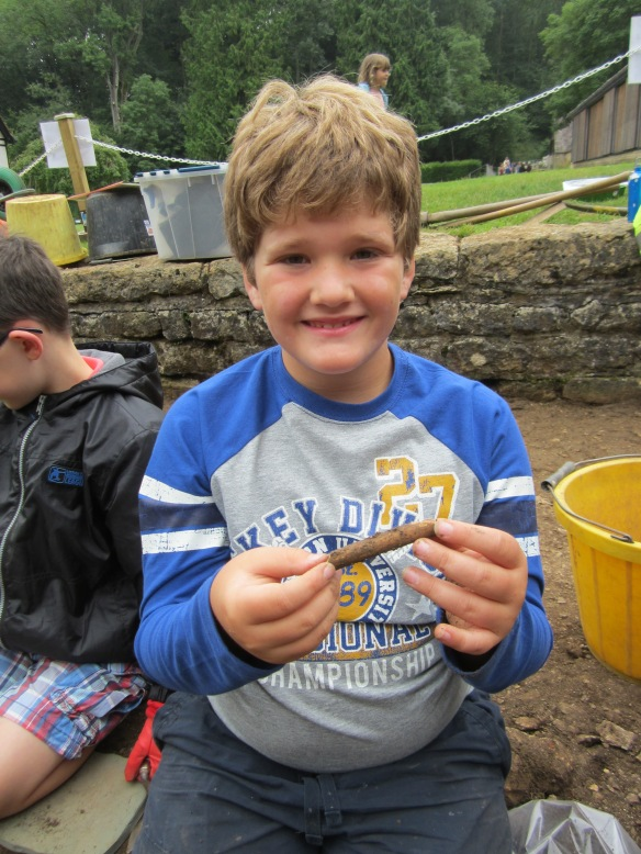Thomas with the sheep bone he found, the remains of a roman snack