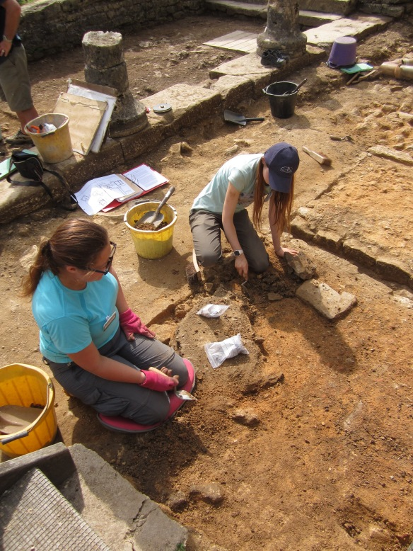 Hannah and Harriet cleaning back the mortar floors