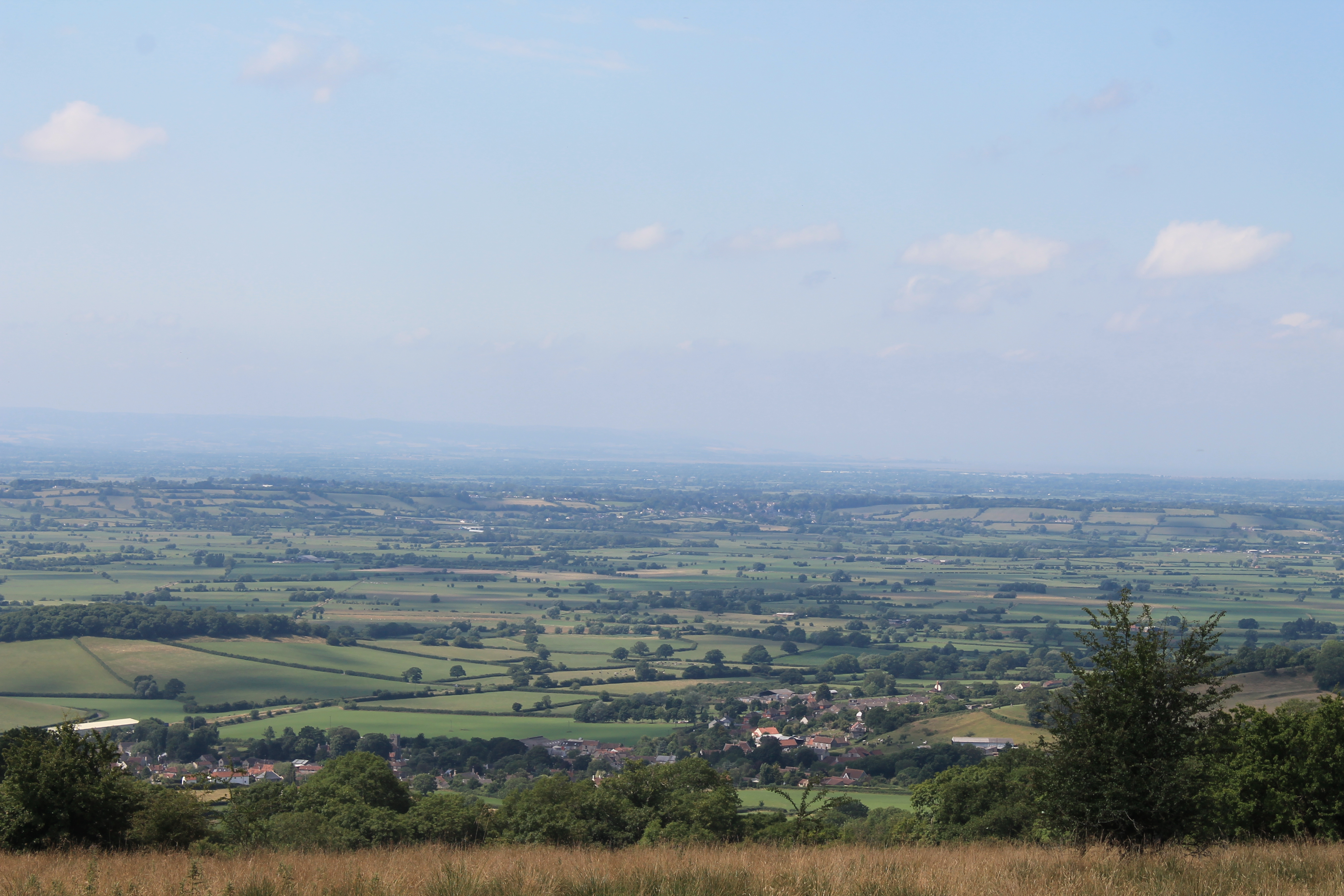 The Somerset Levels looking towards Glastonbury Tor from the Mendips above Ebbor Gorge