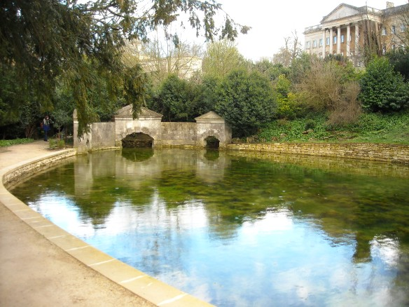 Prior Park, Bath. The 18th century Serpentine Lake and Sham Bridge with Ralph Allen's mansion behind. These buildings were inspired by Roman architecture, very fashionable in the 18th century.