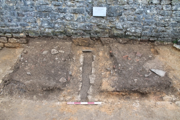 Professor Richmond dug trenches to reveal the central drain of each bath. He left islands of archaeology on each side and these had layers of demolition rubble and floor surfaces within them