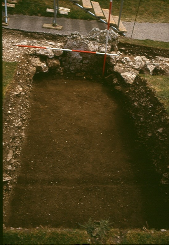 Curious. Below the medieval rubble was a smooth dark layer of soil. A buried turf and in it tobacco pipes and a musket ball or two.
