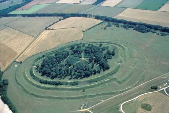 Badbury Rings looking south with the west entrance and barbican on the right. The 6m square excavation trench was just above the entrance through the inner rampart.