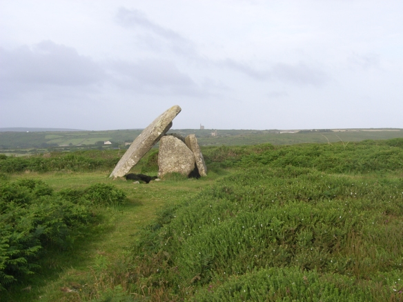 A Neolithic dolmen above New Town in west Cornwall with the familiar outline of a 19th century tin mine engine house behind.