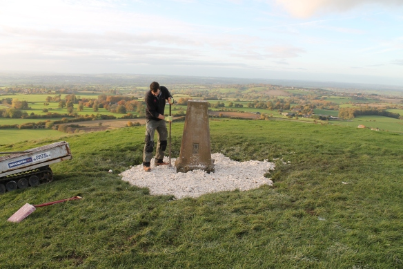 Paul tamping down the chalk around the OS Trig Station. It attracts a lot of erosion.