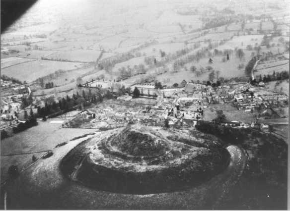 St Michael's Hill in the 1940s when the hill was grass covered and the 'hat-like' shape of the hill was clear. The timber Norman keep once stood on the summit the perimeter defended by palisades. The stables, garrison and store buildings would have been on the lower terrace. Montacute House is middle left in the photo. The priory site is centre right in the field right of the parish church.