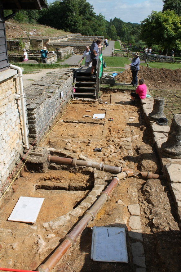 Uncovering  and recording Sir Ian Richmond's excavations of 1958 and 1963 of the early North Range baths, Chedworth.