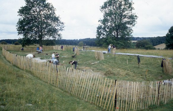 Levelling the spoil from the burrows to enable to rest of the chain-link fencing to be laid.