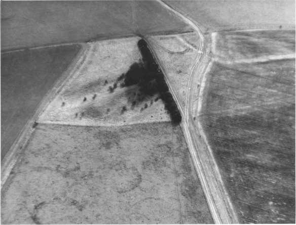 Aerial photograph of White Barrow on Salisbury Plain showing it as an island of  unploughed pasture in a sea of ploughed arable land.