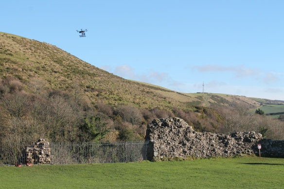 Camera mounted on a radio controlled drone photographing the condition of wall tops at Corfe Castle to determine need for repair after the winter storms and frosts.