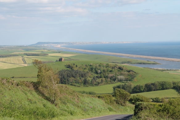 The west end of the Ridgeway from the Iron Age hillfort of Abbotsbury Castle east along the Chesil Beach towards the Isle of Portland.