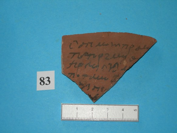 Pottery sherd with writting one one side