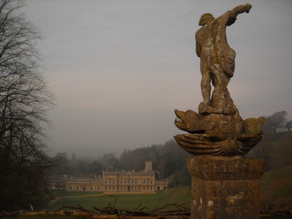 Dyrham from the east. placed on the floor of a natural amphitheatre. The statue of Neptune in the foreground is one of the few visible surviving elements of William Blathwayt's original garden for the house. The formal elements were swept away to create a landscaped Capability-Brown style park in the later 18th cenutury.