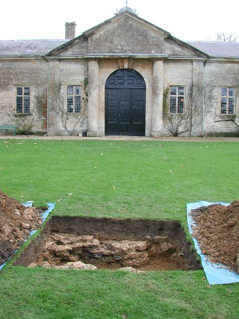 The trench in the lawn in front of Dyrham's stables.  This found the footing for the sphynx statue shown on the 1712 drawing.