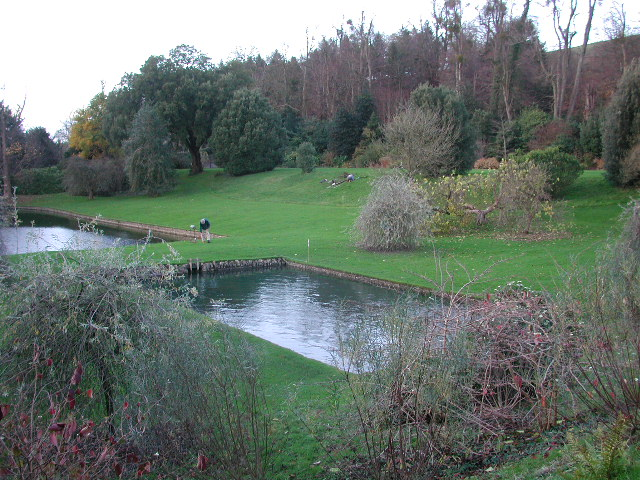 Looking north-west across the lower west garden where the stream that runs under the house emerges as a waterfall feeding two lakes before it leaves the garden and continues through Dyrham village.