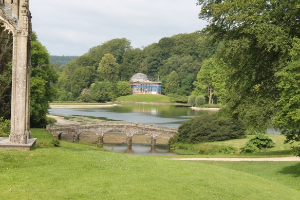 The view from Stourton village would once have been along the stream but this was blocked in the mid 18th century to create a lake. One of the Neo-classical garden buildings, the Pantheon is under repair at the moment. The dam lies to the left.