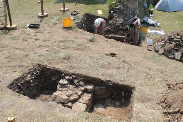 Carol and Kate have uncovered  the face of the 13th century return wall of the 'Constable's House'. In the foreground the smaller 17th century wall.. after a brush down.