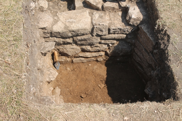 The west side of the 17th century wall. Well built and pointed with orange brown mortar.  The sand and rubble peeled off onto a level gravel floor. Pottery dated this floor to the 17th century.