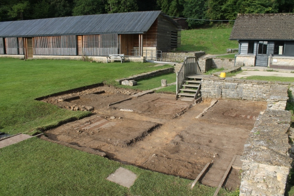 Early morning 6th day after removing covers for photos. The islands between Sir Ian Richmonds wall trenches of 1963. We have lettered them in anti-clockwise order from bottom left 'a', bottom right 'b', 'top right 'c'. then 'd' in front of wooden steps and the 'water feature' is 'e' top left.