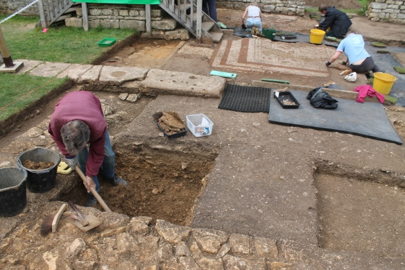 We have put two small trenches into the water feature 'e'. Rob is taking out 19th century backfill. Most of it is Roman debris but from time to time we find Victorian china mixed in with it.