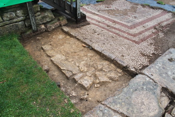 A good sequence of events. On the left an early wall with a contemporary mortar floor. Both cut by the foundation trench for the limestone blocks for the colonnade wall. This was abutted by a curb that had the mosaic laid against it. The stone steps run over the curb and mosaic edge but they were probably rebuilt in the 1860s.