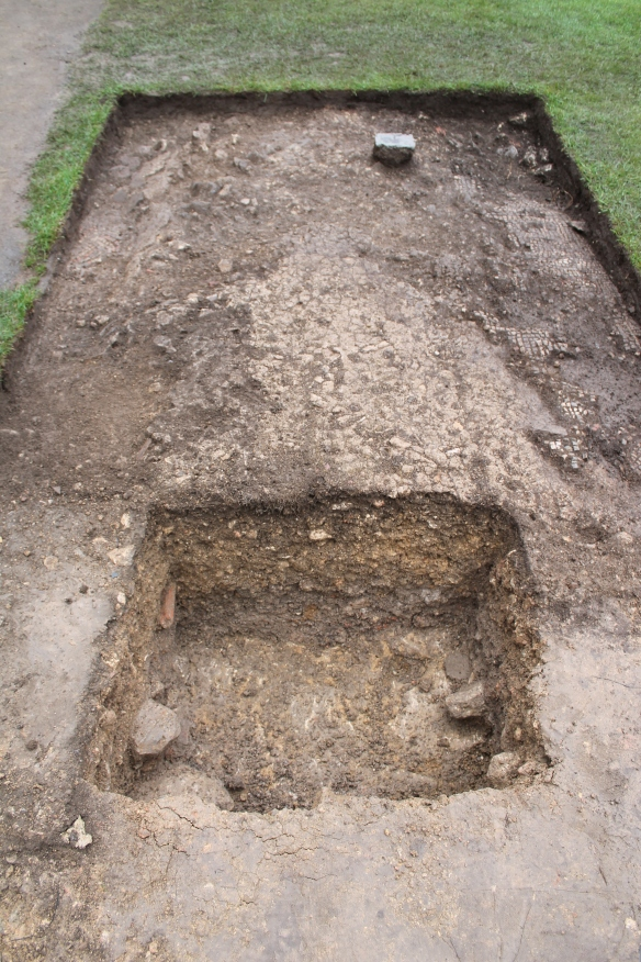 A trench to test one of Sir Ian's walls. This one lay 0.3m deeper than the base of his interpretive concrete walls. The line of the buried wall would have  continued east under the centre of the 'Reception Room' mosaic. Our extension trench only found the mortar bedding for the mosaic with one or two fragments at the edges.