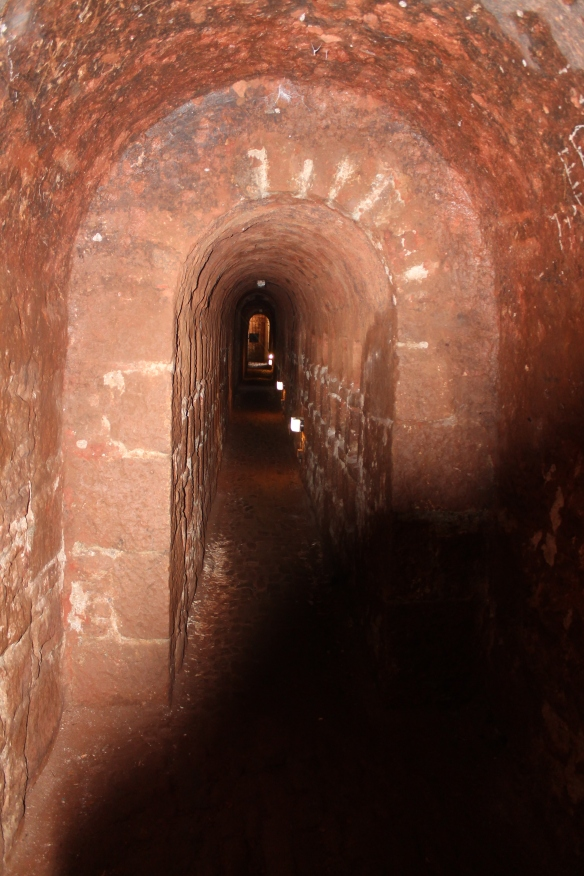 The tunnel from the drying room to the 'man-engine that took the miners down to the work faces. On the right are rows of alcoves to hold clay and candles and other items needed for the mine or left behind by the miners for their return. This was the last walk from the surface for 31 men on 20th October 1919. A short time later the man-engine collapsed.
